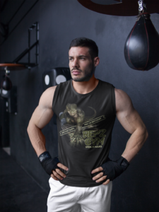 Muscular male in gym wearing custom promotional clothing design tank top.