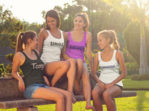 Four young girls wearing custom promotional clothing tank tops