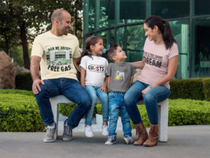 Beautiful family of four wearing custom promotional clothing branded t-shirt designs.