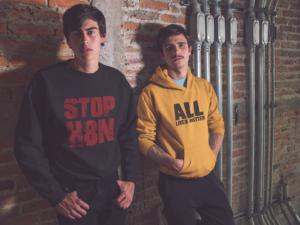 Two young man wearing custom promotional clothing sweatshirt and hoodie.